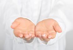 Оpen empty female hands. Holding, giving. Royalty Free Stock Image