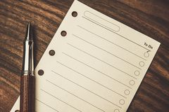 Pen and empty to do list. Luxurious rollerball pen and empty to do list Royalty Free Stock Photo