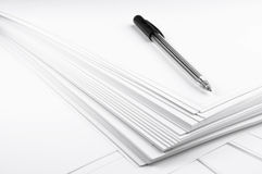 Pen on empty white paper sheets closeup Royalty Free Stock Photography