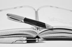 Pen en notitieboekje Stock Fotografie