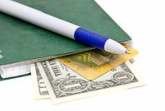 Pen en sommige dollarsbankbiljetten Stock Foto's