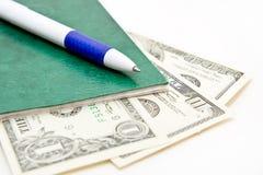 Pen en sommige dollarsbankbiljetten Stock Fotografie