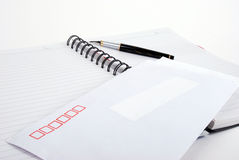 Pen and envelop on  notebook Royalty Free Stock Photography