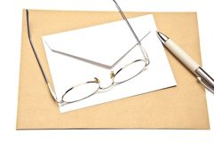 Pen envelope and glasses Stock Photography