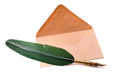 Pen and envelope isolated. Quill pen and envelope isolated Royalty Free Stock Photography