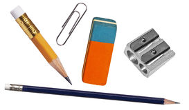 Pen, eraser, paper clip  and sharpener Royalty Free Stock Image