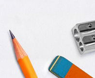 Pen, eraser and sharpener Stock Images