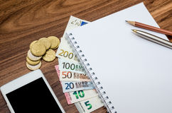 Pen, euro banknotes and calculator, mobile and empty notebook Royalty Free Stock Photography