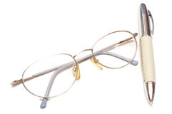 Pen and eye glasses Royalty Free Stock Photos