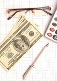 Pen, eyeglass, and calculator on the working paper Royalty Free Stock Images