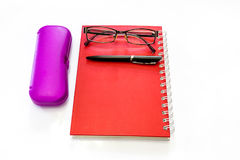 Pen and eyeglasses on a notebook. Royalty Free Stock Photography
