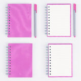 4 Pen and Face purple notebook on tablecloth Royalty Free Stock Images