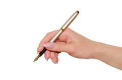 Pen in a female hand. Isolated on white background Stock Photography