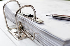 Pen on file folder with documents, storage of contracts. selecti Royalty Free Stock Photo