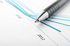 Pen and finance chart Royalty Free Stock Image