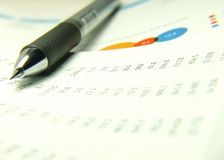 Pen and finances statement. With charts Royalty Free Stock Photos