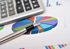 Pen and financial chart Royalty Free Stock Image