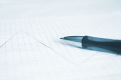 Pen and financial graph Stock Photo