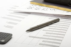 A pen and financial statement Stock Photography