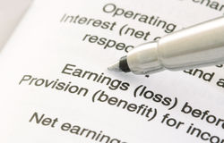 Pen on Financial Statement. A pen is pointing at the word Earing Royalty Free Stock Photo