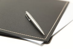 Pen and folder close up Royalty Free Stock Images