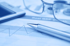 Pen gasses and calculator on financial chart and graph, accounti. Ng background Stock Photography