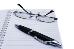 Pen and glases on notebook. Stock Images