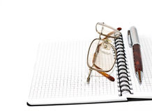 Pen and glasses Stock Image