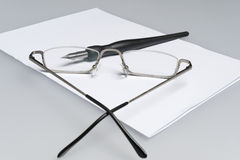 Pen through glasses Stock Image