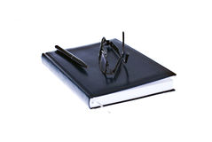 Pen, glasses and agenda. Office instruments Stock Photography
