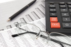 Pen, glasses and calculator Royalty Free Stock Photos