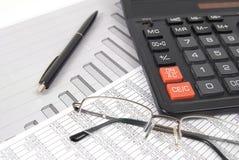 Pen, glasses and calculator Stock Photo