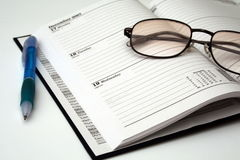 Pen and Glasses on a diary Royalty Free Stock Photography