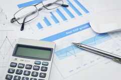Pen and glasses on financial chart and graph, accounting backgro Stock Photo