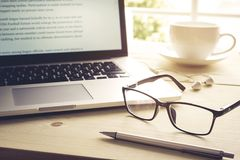 Pen and glasses with laptop.Inspiration moment Royalty Free Stock Image