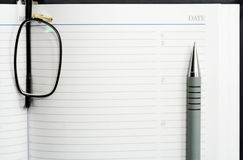 Pen, glasses and notebook. Stock Images