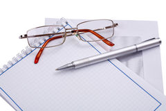 Pen, glasses and papers Stock Photo