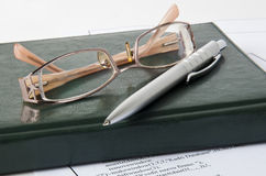 Pen,glasses and report Royalty Free Stock Images