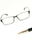 Pen and glasses, on a white Stock Images