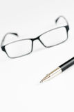 Pen and glasses, on a white Royalty Free Stock Image