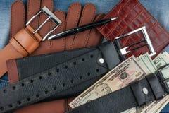 Pen, gloves, purses, belts and money Stock Photos