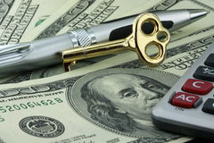 Pen, gold key and hundred Dollar bill Stock Images