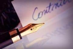 Pen with golden nib Stock Photo