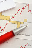 Pen on Graph. With notebook on the upper left Royalty Free Stock Photo