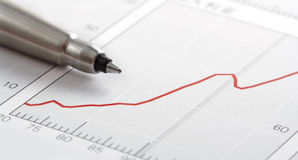 Pen on graph. (close-up Stock Photo