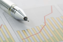 Pen on Graph. (focus on the tip of the pen Royalty Free Stock Photo