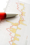 Pen on Graph. (focus on the tip of the pen Stock Image