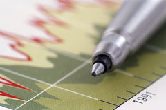 Pen on Graph. Focus on the tip of the pen Stock Photo