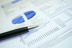 Pen and graph on financial figures royalty free stock photos