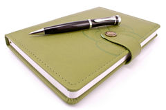 Pen and green notebook Stock Photos